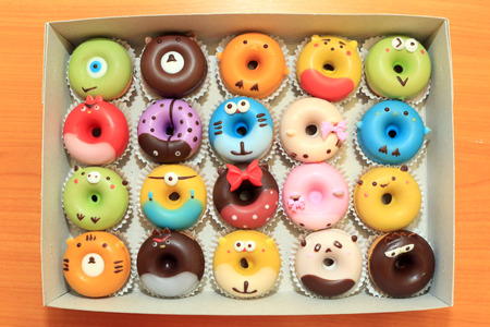 Collection of lovely cute cake donut for children birthday partty, Cartoon childlike character doughnuts for kids, Lovely snacks. 版權商用圖片