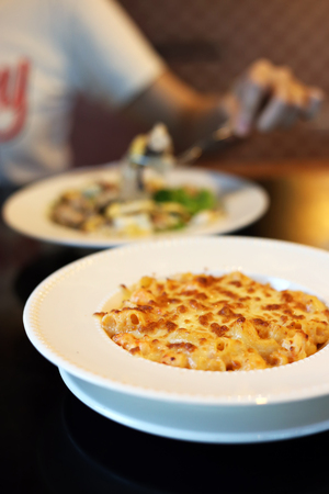 Baked Macaroni and cheese with shrimp dish. Italian food style. Stock fotó