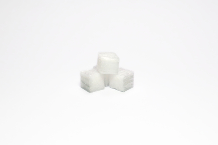 Srerile collagen cube heap isolated in white background. Raw material use for cosmetic product such as facail mask.