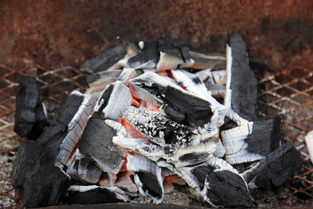 Charcoal burning in stove for cooking barbeque. Imagens