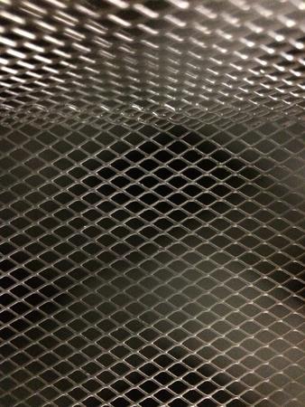 grid: Metal texture background dark