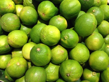 Green lemon in the market Stock Photo