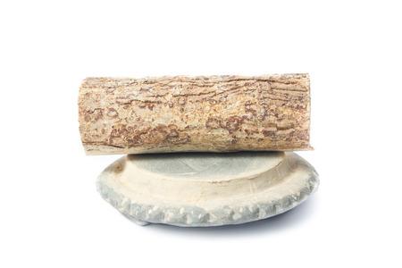 Thanaka wood and Kyauk Pyin stone slabs on white background Stock Photo