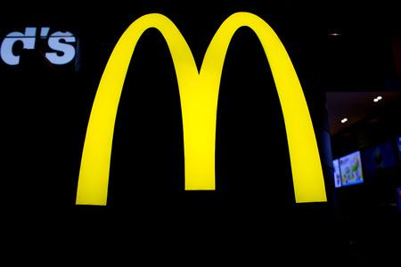 macdonald: BANGKOK, THAILAND - FEBRUARY 10 : Logo of McDonalds Restaurant on February 10, 2015 in Bangkok, Thailand. It is the worlds largest chain of hamburger fast food restaurants.