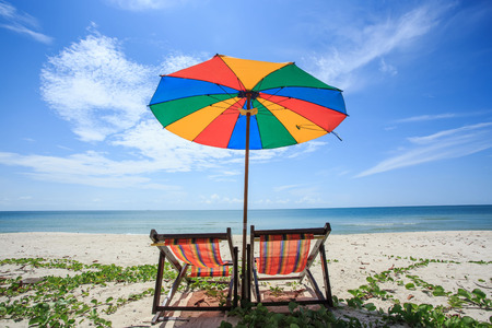 white beach: chair and colorful umbrella on the beach