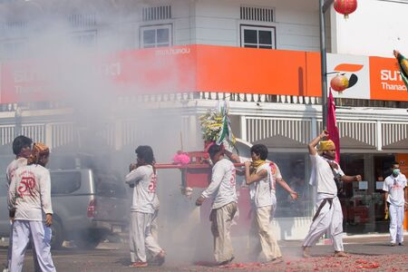 appease: SURAT THANI, THAILAND - APRIL 3 , 2015 : Surat Thani Vegetarian Festival on April 3, 2015 in Surat Thani, Thailand. During the festival ritual mortification is practised to appease the Gods.