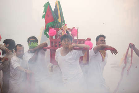 practised: SURAT THANI, THAILAND - APRIL 3 , 2015 : Surat Thani Vegetarian Festival on April 3, 2015 in Surat Thani, Thailand. During the festival ritual mortification is practised to appease the Gods.