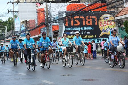 surat: SURAT THANI, THAILAND - AUGUST 16 : Unidentified riders in action during Bike for Mom event on August 16, 2015 in Surat Thani, Thailand. Bike for Mom is the event for celebrates queens birthday.