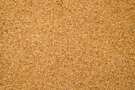 Close-up of brown cork board texture background. Empty bulletin board, natural texture detail with free space copy for text. Standard-Bild