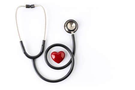 Close-up of Black stethoscope with red heart of doctor for checkup on white background. Stethoscope equipment of medical use to diagnose hear sound. Health care and cardiology concept with copy