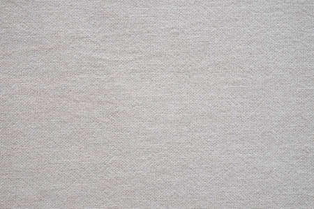 Close-up of Beige color natural fabric cloth texture background. Material is used in the textile assembly. New abstract surface design structure with empty, copy space for wallpaper.