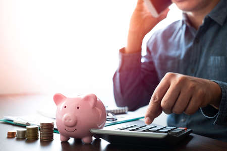 Close-up image of pink piggy bank with money stack step up growing growth. Planning step up, saving money for future plan, retirement fund. Business investment-finance accounting concept. Zdjęcie Seryjne
