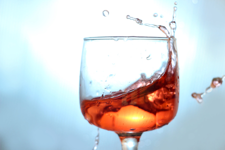red wine being poured into glas Stock Photo - 25071765
