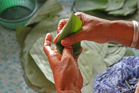 Old man hand cutting the  banan leaf