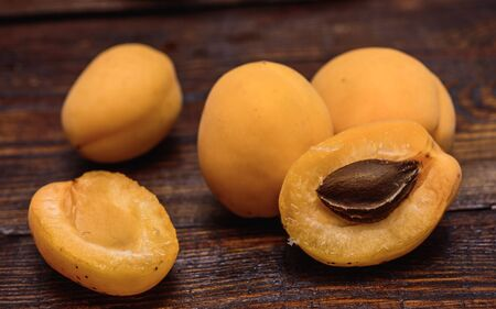 pip: two half of apricot with pip on dark wooden background