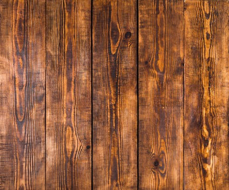 Old wooden panels with cracks, scratches, swirls, notch and chips. Background with space for text