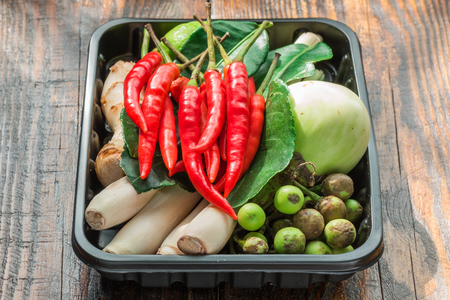 plactic: Tom yam ingredients set for Thai cooking in black plactic pallet on wooden table