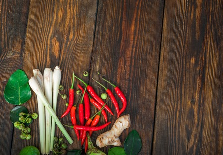 Thai cuisine ingredients set on rural wooden table. Place for text. Stock Photo