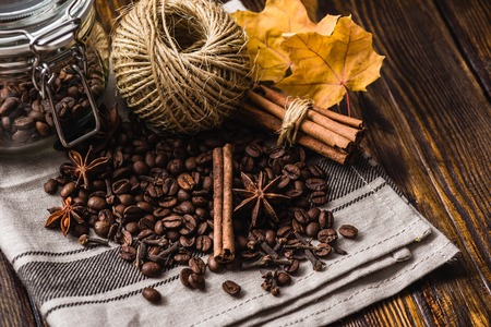 Coffee Beans with Autumn Leaves and Spices.
