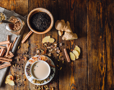 Ingredients for Masala Chai and Cup with Beverage. View from Above and Place for Text. Stock Photo