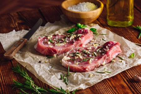 rib eye: Two Rib Eye Steak Prepared with Spices for Frying
