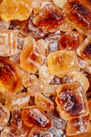 Textured Background of Candy Brown Sugar. Vertical Orientation.