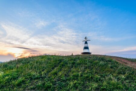 Beacon with the pointer Volga and Kama rivers on the hill in sunset light