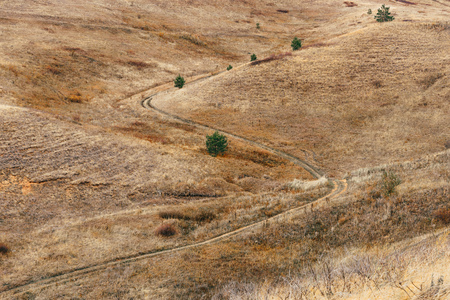 S curve of dirt road on the hillside Stock fotó