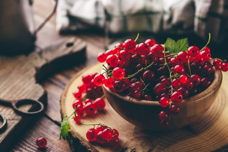 Fresh picked red currants in wooden bowl Stock Photo