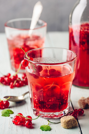 Infused water with fresh red currant and cane sugar