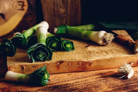 Fresh green leek on cutting board with knife Banco de Imagens