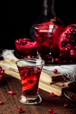 Pomegranate liqueur with fresh fruit in shot glass Stock Photo