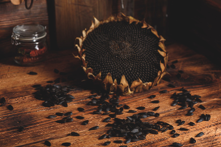 Dried sunflower and roasted seeds on the old wooden table