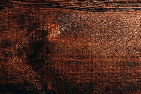 Old dark wooden surface. View from above