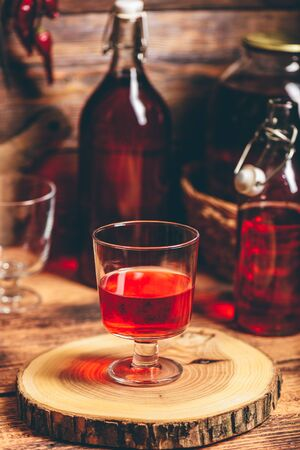 Homemade red currant liquor in a drinking glass
