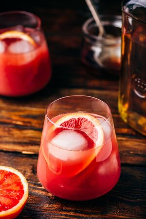 Whiskey sour cocktail with aged bourbon, blood orange juice and simple syrup Reklamní fotografie