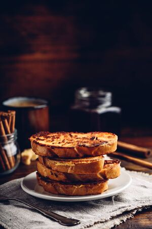 French toasts on white plate over wooden surface Reklamní fotografie
