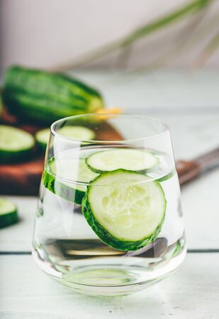 Infused water with sliced cucumber in a drinking glass Reklamní fotografie