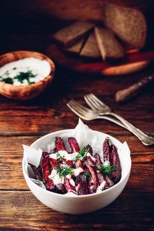 Oven baked beet fries with greek yogurt and dill dressing Reklamní fotografie