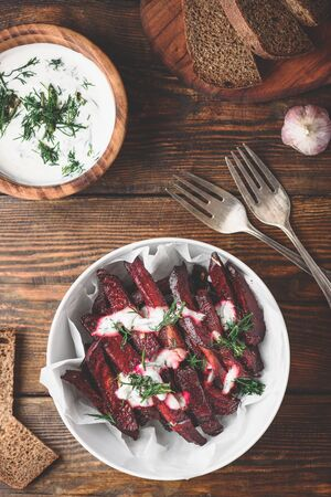 Oven baked beet fries with yogurt and dill dressing