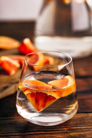 Infused water with bloody oranges in drinking glass Reklamní fotografie