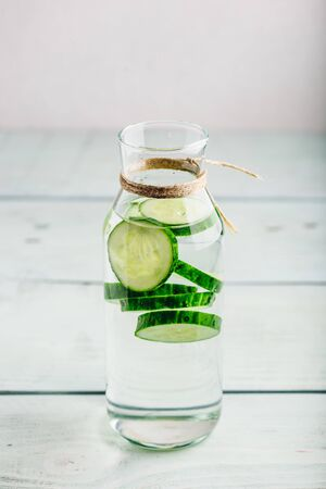 Infused water with sliced cucumber in glass bottle Reklamní fotografie