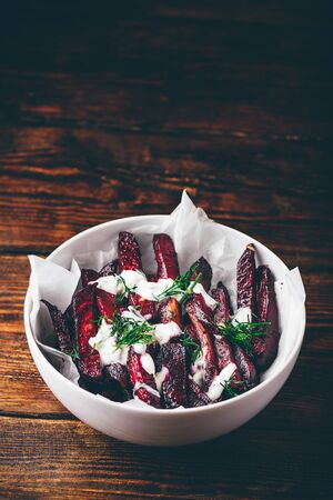 Oven baked beet fries with sour cream and dill dressing