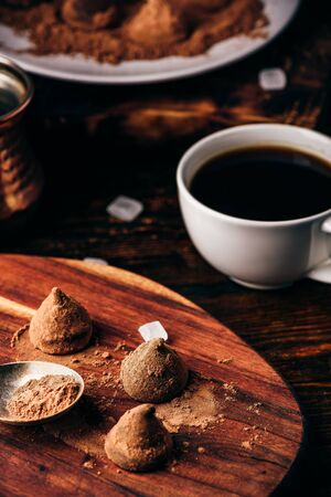 Homemade chocolate truffles coated in cocoa powder with black coffee Reklamní fotografie