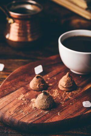 Homemade chocolate truffles coated with black coffee