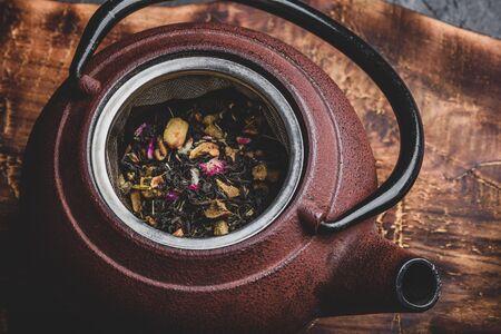 Preparing herbal tea with fruit pieces. High angle view Фото со стока