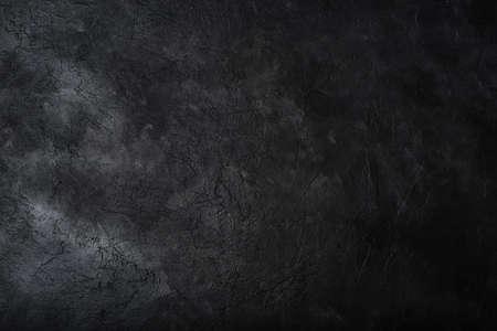 Dark textured concrete wall background. Copy space