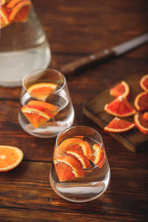 Detox water with blood oranges in drinking glass