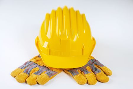 YELLOW HARD HAT AND WORK GLOVES