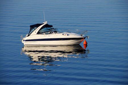 Anchored motor boat  Stock Photo